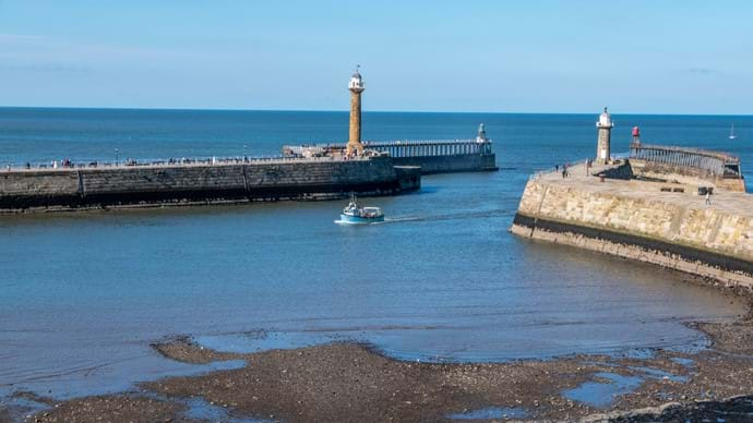 Whitby piers and lighthouse