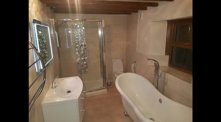 The bathroom has relaxing colour changing lights to help guests relax in the bath