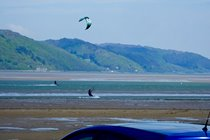 Kite surfers at the Dovey estuary, from Ynyslas sand dunes.