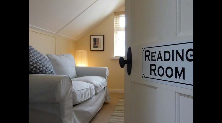 Relax with a book - or your tablet - in our upstairs Reading Room