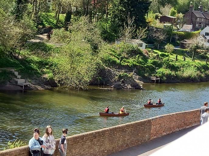 Enjoy watching canoes go by the lounge