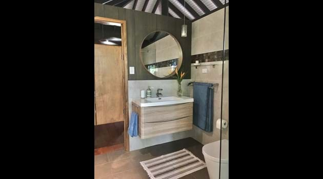 Well appointed bathroom with ample storage, includes hairdryer for guest use