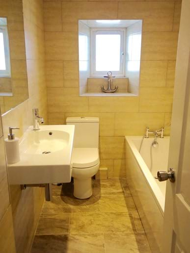 There are two bathrooms - the downstairs bathroom has a bath and WC