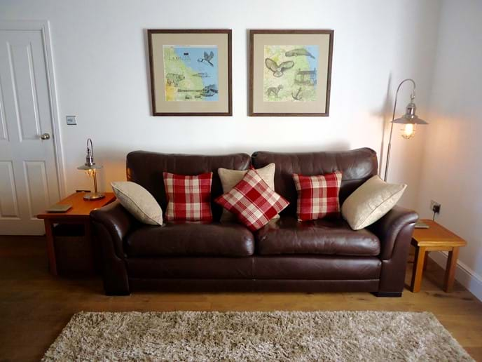The leather sofa and armchairs are very comfortable, and the original artwork depicts local scenes and wildlife