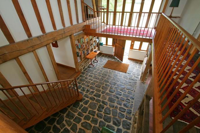 The entrance hall of The Barn, Boudet, Normandy with a bespoke galleried landing