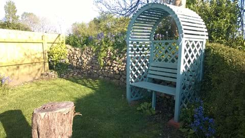 Why not take a good book and relax at the end of the garden