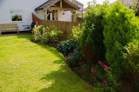 Flower beds in rear enclosed Garden