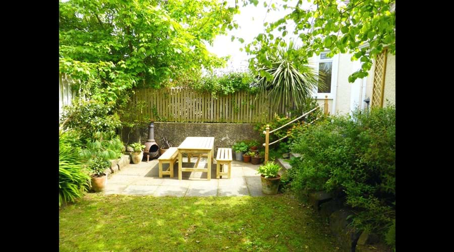"Our ""secret"" garden offers privacy along with a picnic table and bbq"