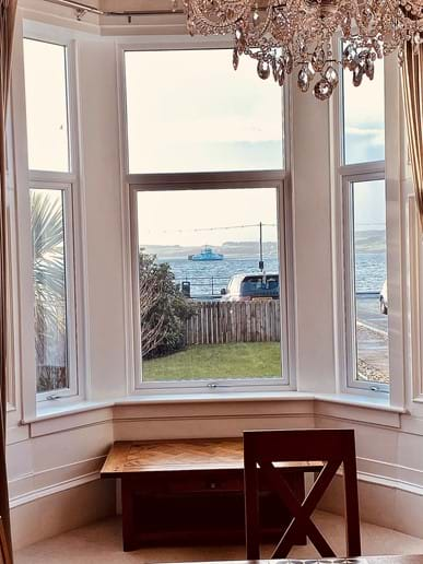Watching the ferry come and go to Cumbrae from the dining room
