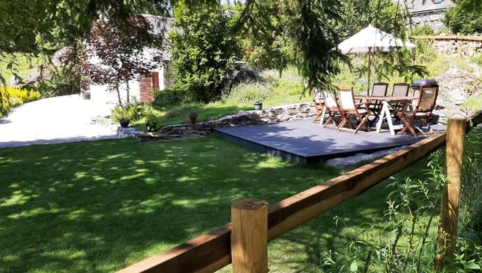 New outdoor decking patio and lawn. Dog proof fencing