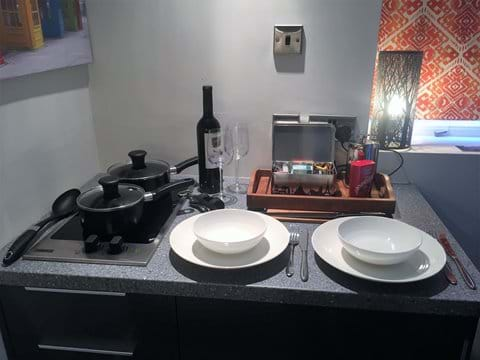 Royal Doulton crockery, Sheffield steel cutlery and all the utensils you need.