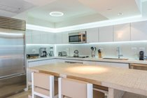 """White quartz kitchen counters and Yakarta blanco porcelain backsplashes"""