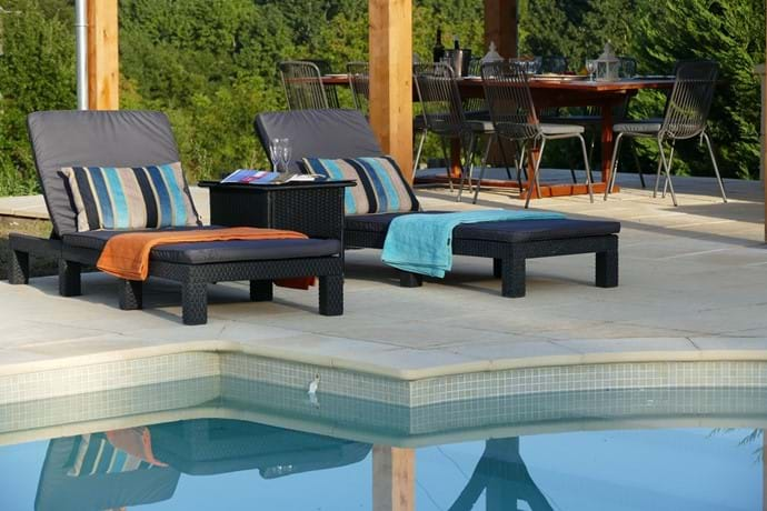 All weather rattan loungers around the pool