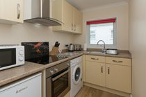 Modern fully equipped kitchen with washing machine