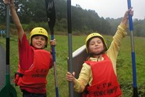 2 youngsters enjoying an outing to the kayaking centre at nearby Torchamps