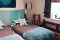 Chapel Bay Lodge bedroom with two single beds