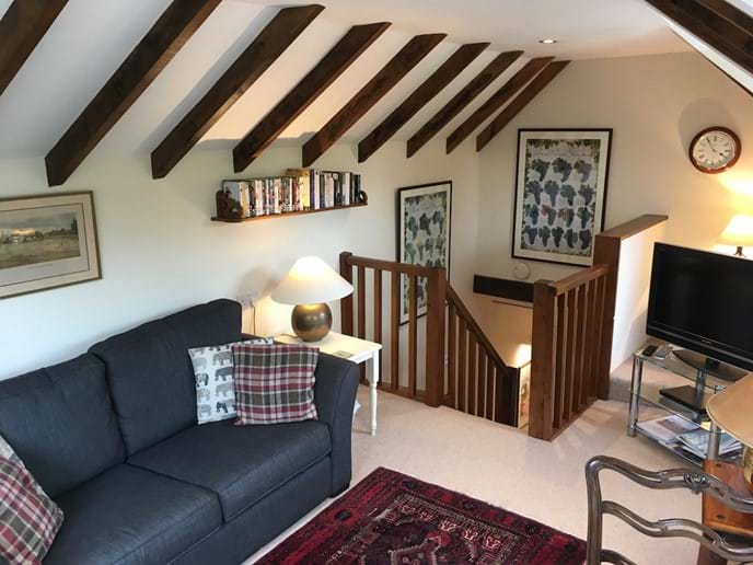 Leat Cottage sitting room and stairs down to kitchen and bedroom