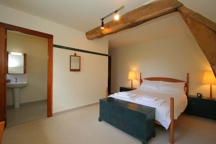 The second en suite double bedroom with king size bed, plenty of built in storage and an en suite shower room with basin and WC