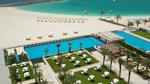 """Welcome to Dubai - View of Al Bateen pool area and beach to the right Hilton Hotel pool area on left"""