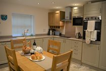 Modern Kitchen with electric cooker and hob, microwave, fridge, freezer, dishwasher and washer/dryer