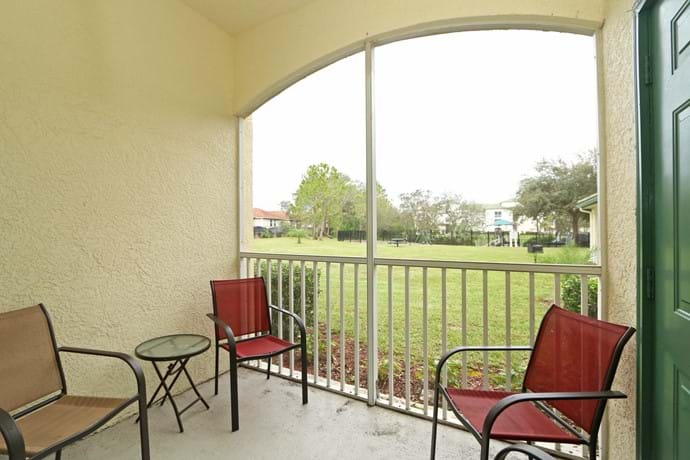 The screened balcony at 13-102  with view over lawns to the Children