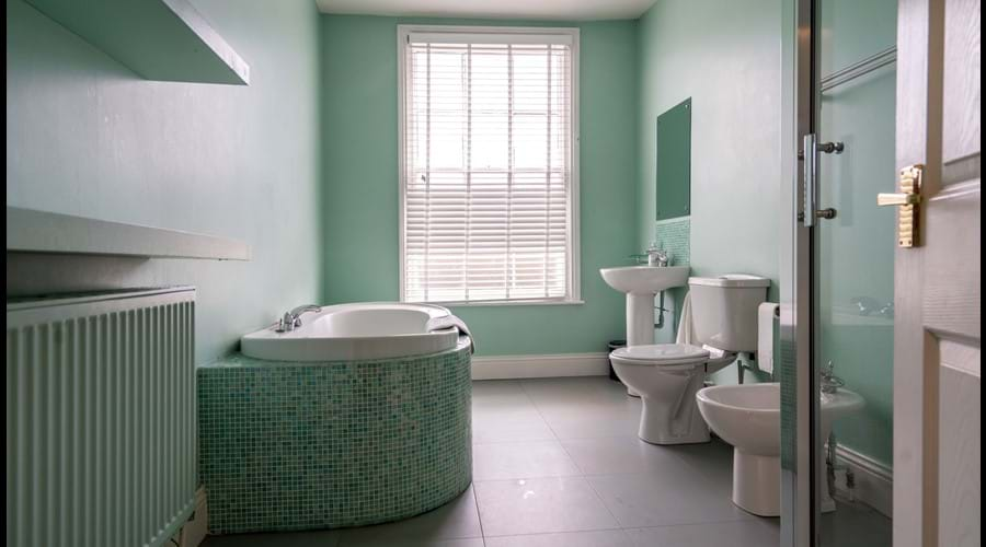 1st Floor Family Bathroom with large shower cubicle, separate bath, washbasin, wc and bidet