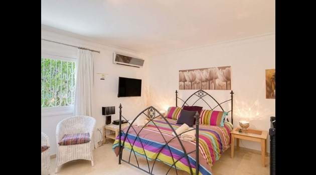 Bedroom 2 has a king size bed + cot + baby monitor + air con faces the family bathroom