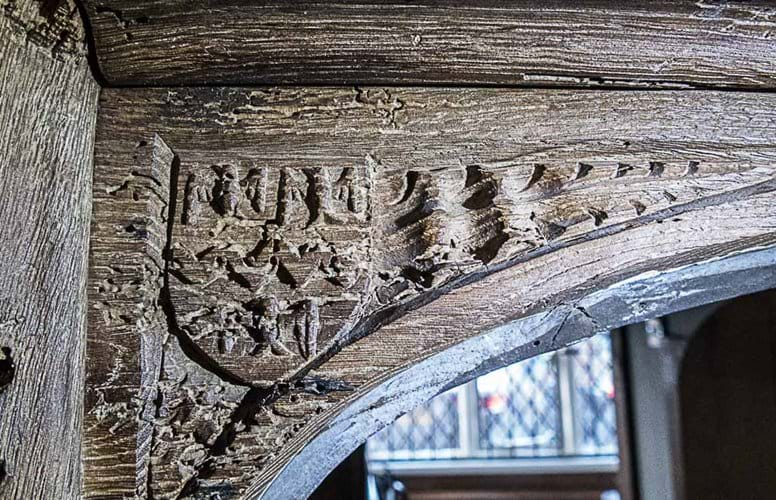 Spandrel with Taylour coat of arms, a tease, dancettes, ermines between three eagl s