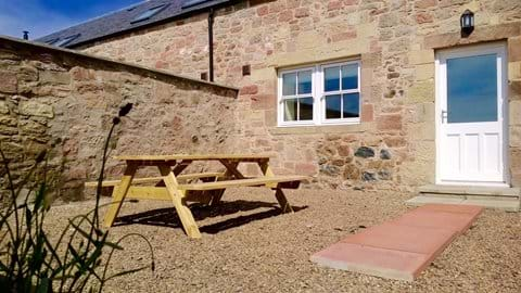 Relax in the sun trap courtyard garden, with BBQ