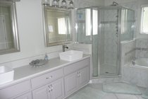 Upstairs master bathroom recently remodelled with vessel sinks