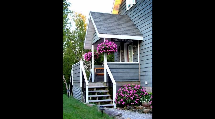 There are always plenty of flowers to brighten the exterior of the cottage.