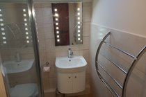 Ensuite complemented with illuminated mirror and chrome accessories