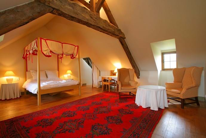 The master bedroom suite on the top floor of The Farmhouse with en suite shower room