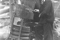View of an apprentice heating rivets at the North Sands shipyard of J.L. Thompson & Sons Ltd, Sunderland, 1946, (TWAM ref. DS.JLT/5/3/16).