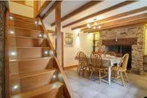 Dining room with log burner.