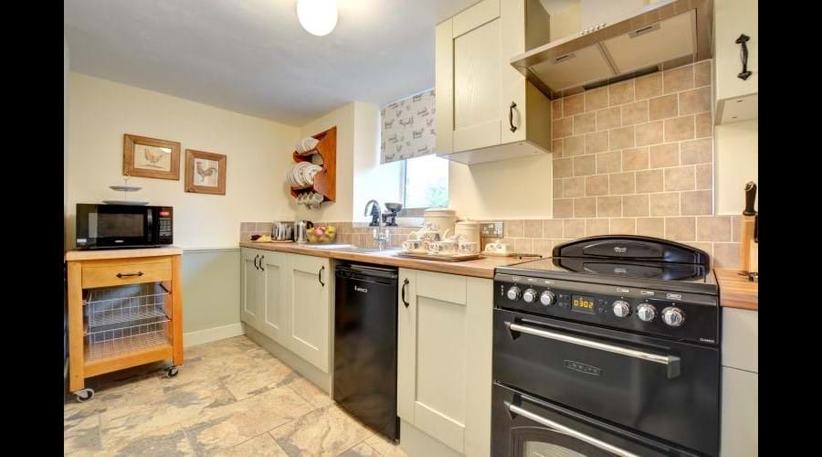 A fully equipped kitchen with Mini electric range, fridge with ice box and microwave....