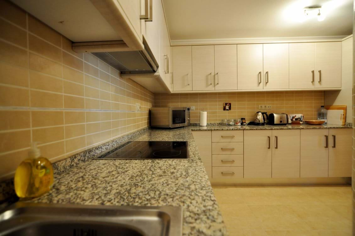 Large Kitchen inc ceramic hob, electric oven, fridge freezer and storage from end to end.