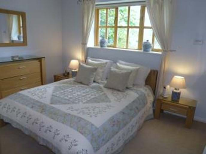 Master bedroom, with king size bed and en suite bathroom