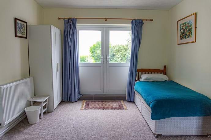 Single bed in family room