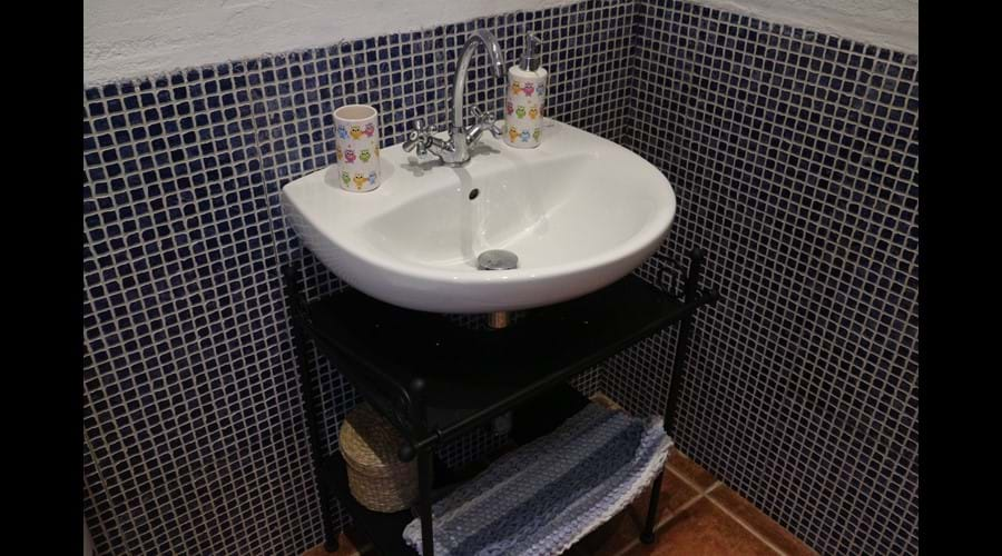 There are two shower rooms each also with basin and toilet