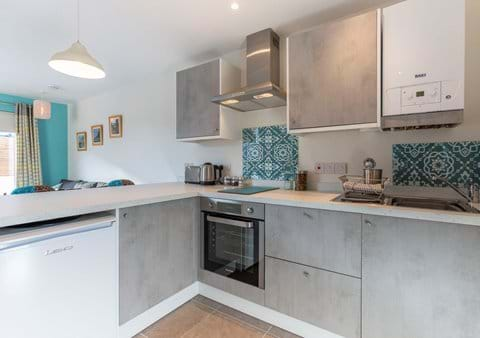 Fully fitted brand new kitchen with induction hob, oven, fridge, microwave and everything you need for cooking and eating in