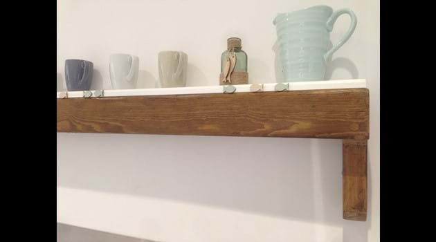 Re-purposed church pew as kitchen shelf