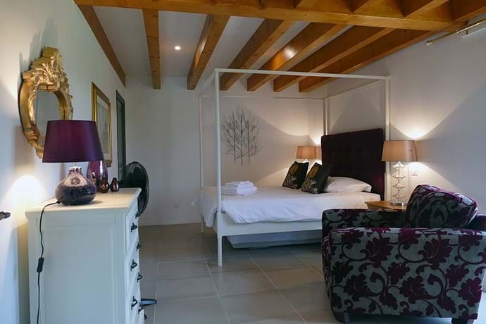 Bedroom One in Le Noyer is on the ground floor with French doors leading to the garden
