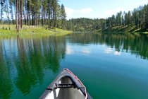 Great place for a row around the lake in our 3 seat canoe