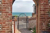 Archway to the Dell and the sea