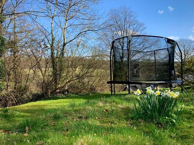 Enclosed trampoline