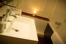 Benbow Cottage - Main bathroom with bath and walk in shower