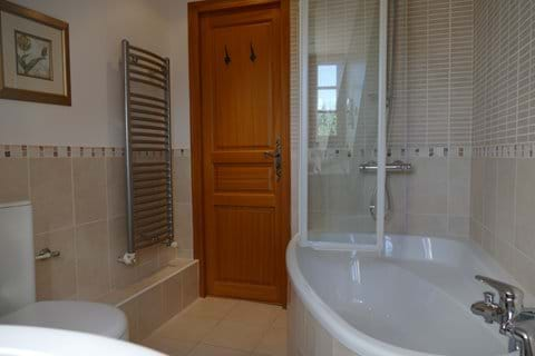 This is the bathroom on the second floor with a corner bath and shower over