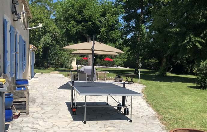 House terrace with table tennis, dining table and BBQ