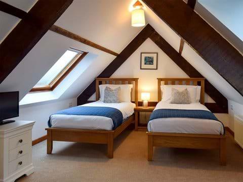 Vaulted mezzanine twin bedroom